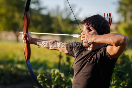 young archer training with the