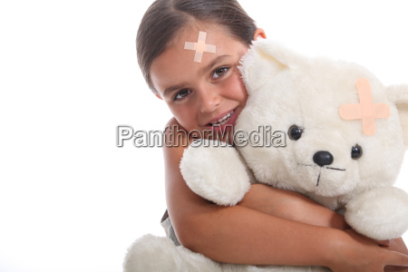 young girl and her teddy bear