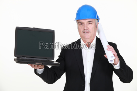 a mature architect with a laptop