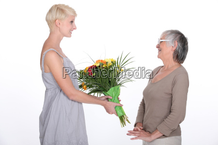 young woman offering a bouquet of