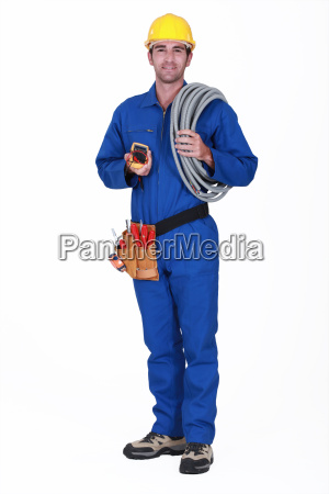 tradesman holding his tools and corrugated