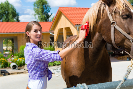 young woman in the stable or