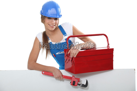an attractive tradeswoman holding a pipe