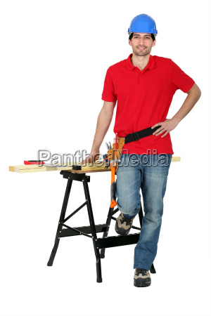 man with wood a workbench and