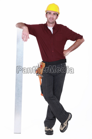 tradesman leaning against a girder