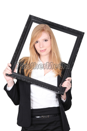 young woman putting herself in a