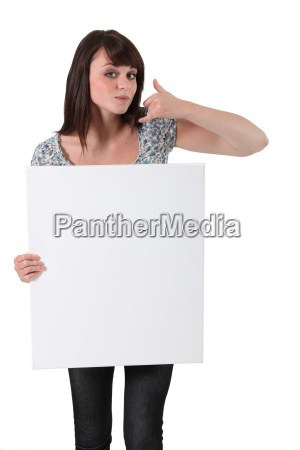 brown haired girl holding white panel