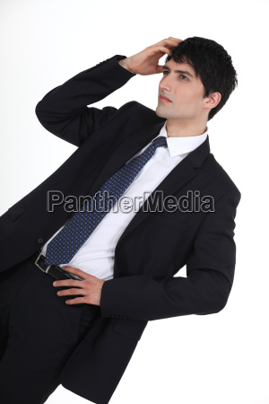 young businessman scratching head