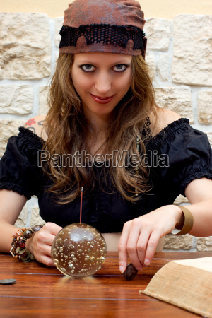 clairvoyant with a ball looks at