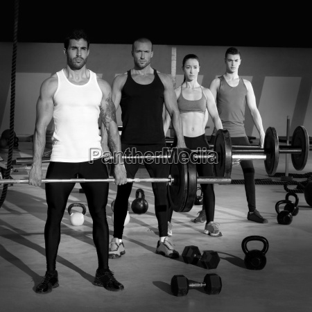 gym group with weight lifting bar