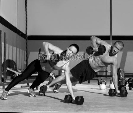 gym man and woman push up