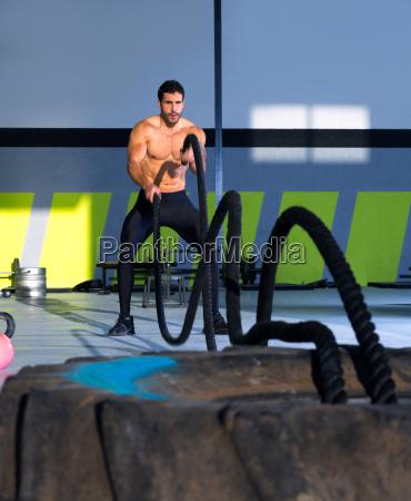 crossfit battling ropes at gym workout