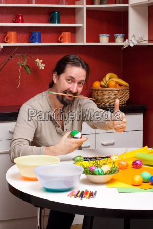 man with easter eggs keeps thumbs