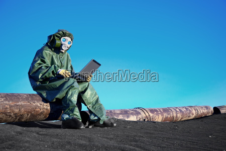 scientist with a laptop on chemically