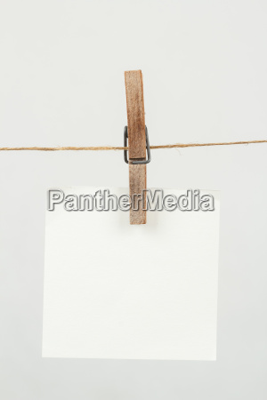 memory note paper hanging on cord