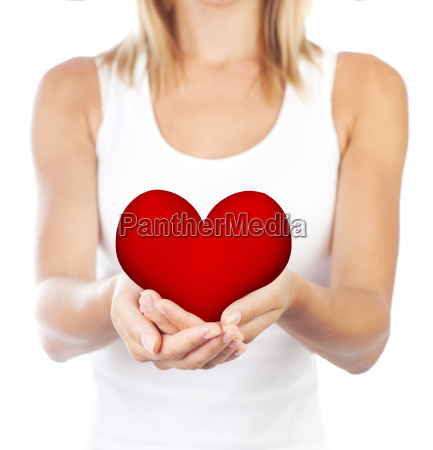 healthy woman holding heart selective focus