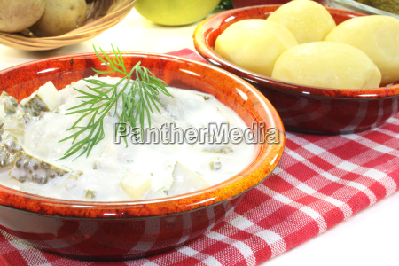 marinated cream herring with sour cucumber