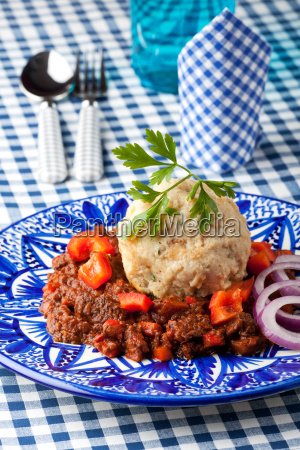 goulash with dumplings on a plate