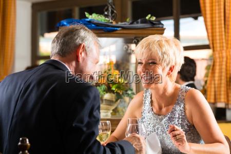 senior couple eating in a restaurant