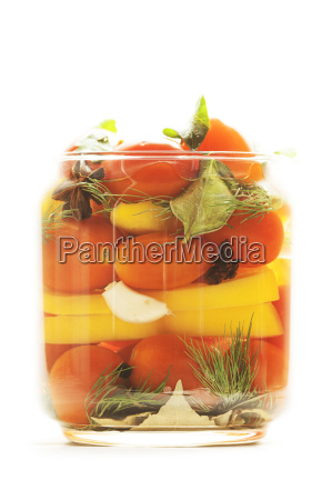 canned vegetables against white background