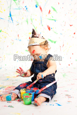 sweet little child in overalls with