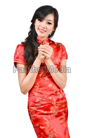 pretty girl with cheongsam wishing you