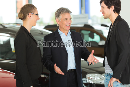 elderly man with cars and young