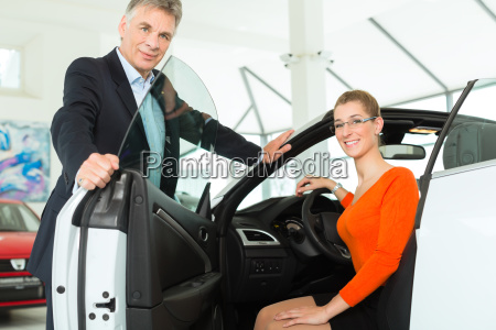 young woman in seat of car