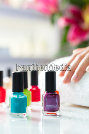 woman in nail salon gets manicures