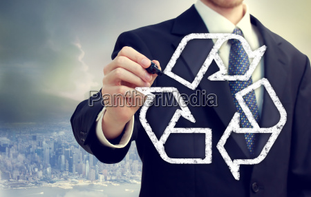 businessman drawing recycle sign