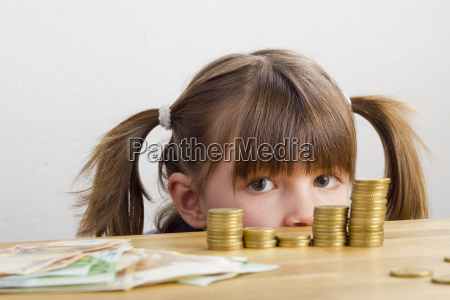 girl looking at money towers