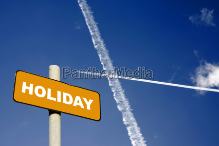 holiday sign with jet trails in