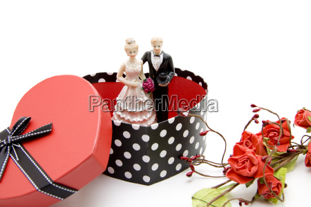 bride and groom in heart box