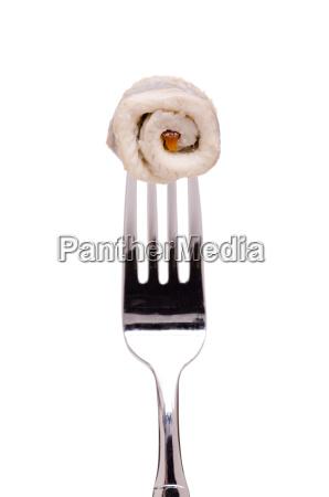 filete de arenque en un tenedor