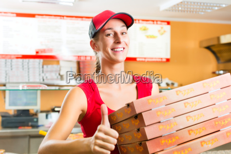delivery woman with pizza boxes