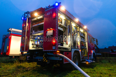 firefighters in action with blue light
