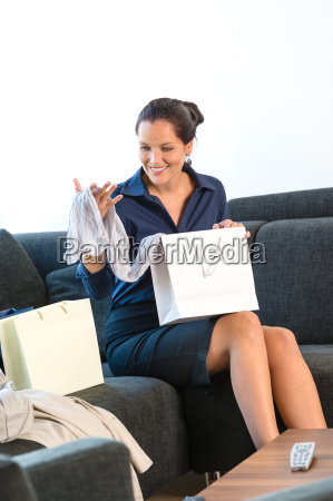 cheerful woman looking clothes gift present