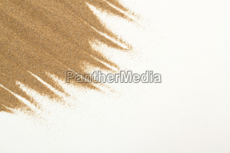 closeup of sand on a white