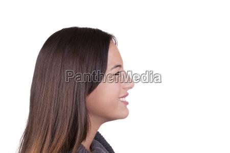 smiling caucasian teen girl profile portrait