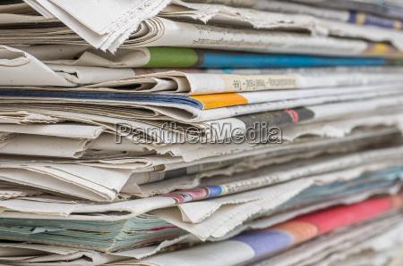closeup of a newspaper stack