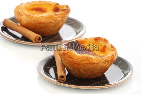 custard pies with cinnamon sticks