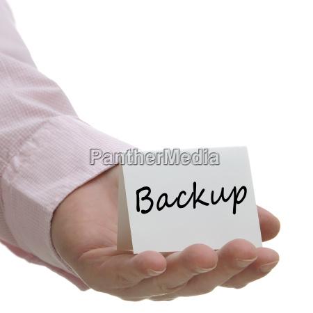businessman holding backup sign