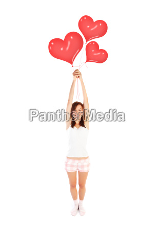 girl with heart balloons