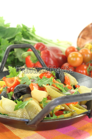 freshly cooked pasta dish with peppers