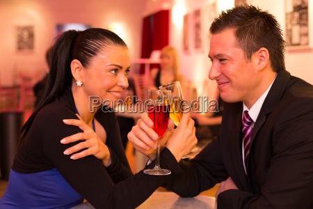 couple in love enjoying drinks