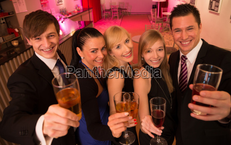 a group of five friends celebrating