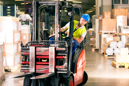 forklift operator in warehouse of speditionng