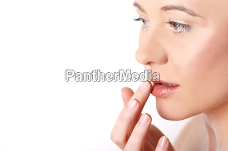 young woman putting cream on her