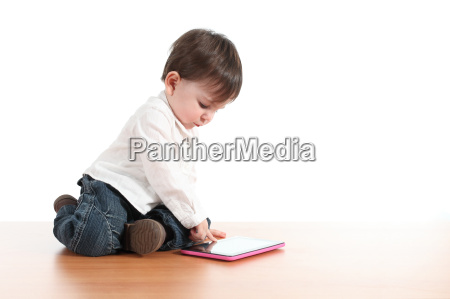 baby playing with a digital tablet