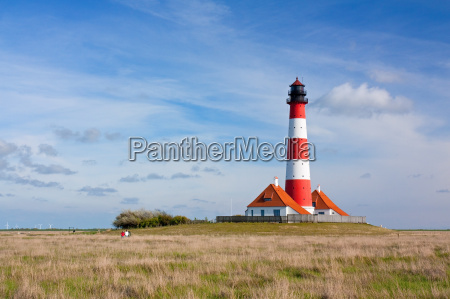 lighthouse westerhever with salt marshes